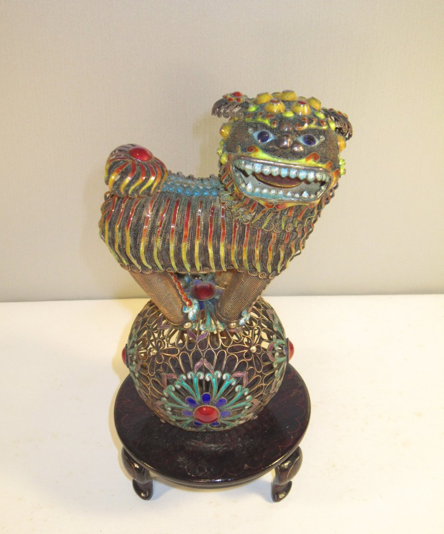 A Chinese Enameled Silver Foo Dog Standing on Ball