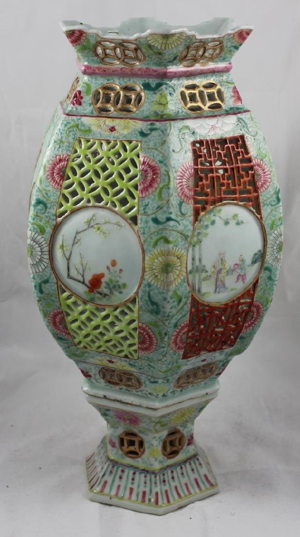 A CHINESE EXPORT PORCELAIN FAMIILE ROSE RETICULATED