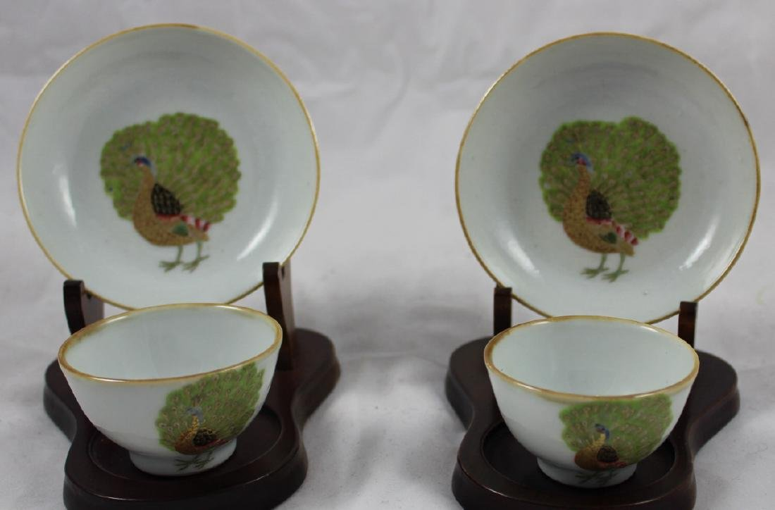 SET OF FOUR CHINESE FAMILLE ROSE 'PEACOCK' CUPS AND