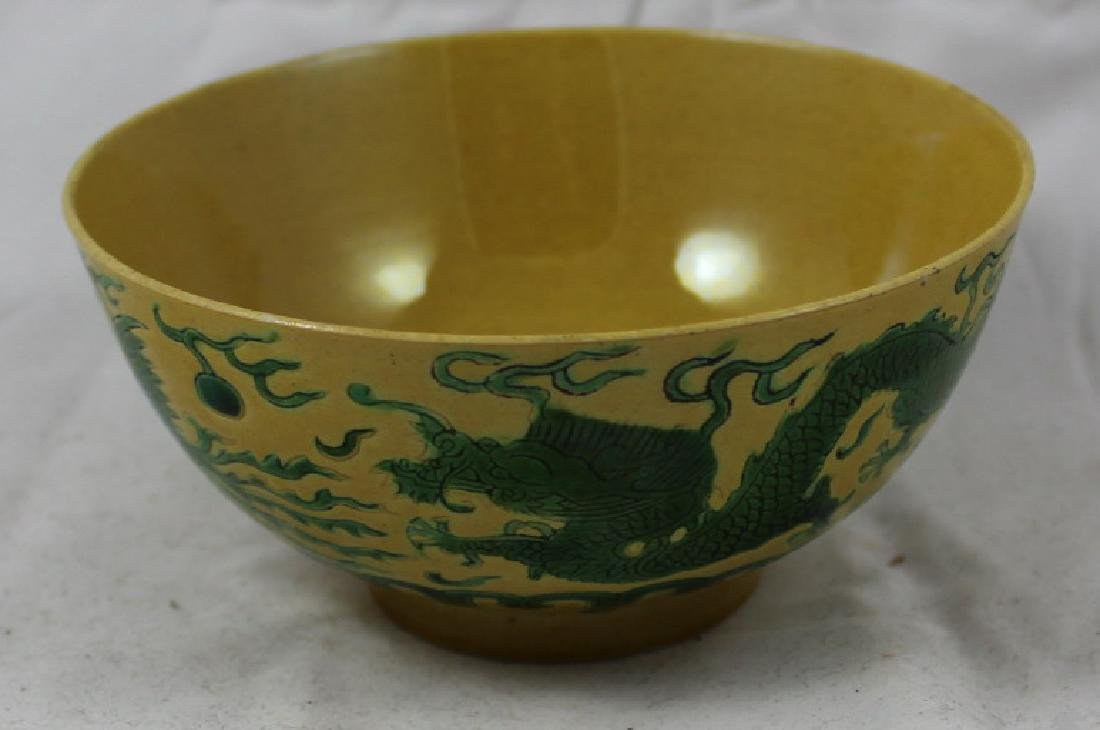 A CHINESE FAMILLE JAUNE DRAGON BOWL