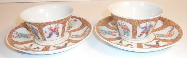 A pair of Chinese export famille rose tea cups and sauc