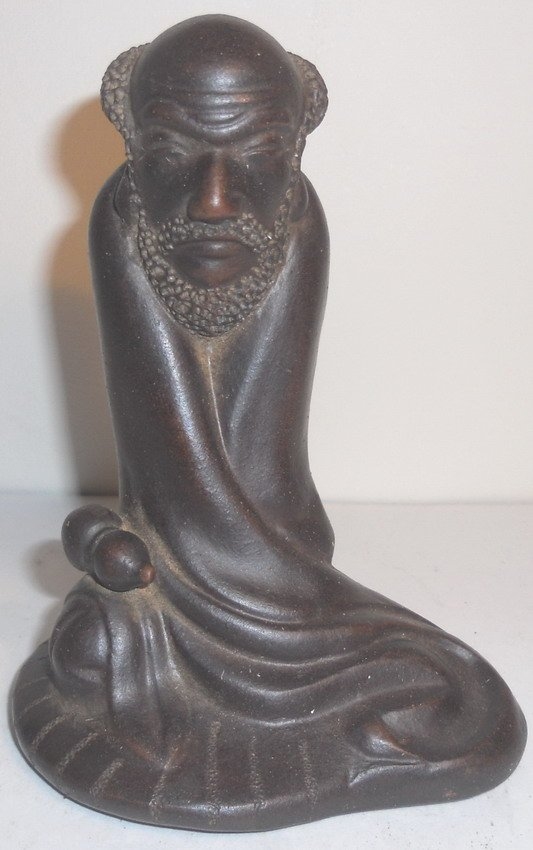 A Chinese YiXing figurine.