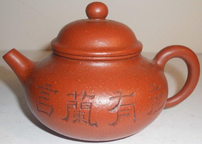 A Chinese Yixing teapot.