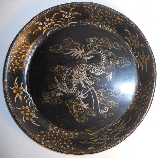 A Chinese lacquer plate.