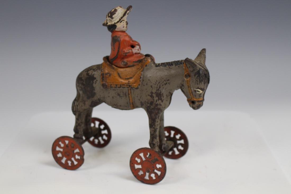 Cast Iron Lady Riding Donkey, Action Toy