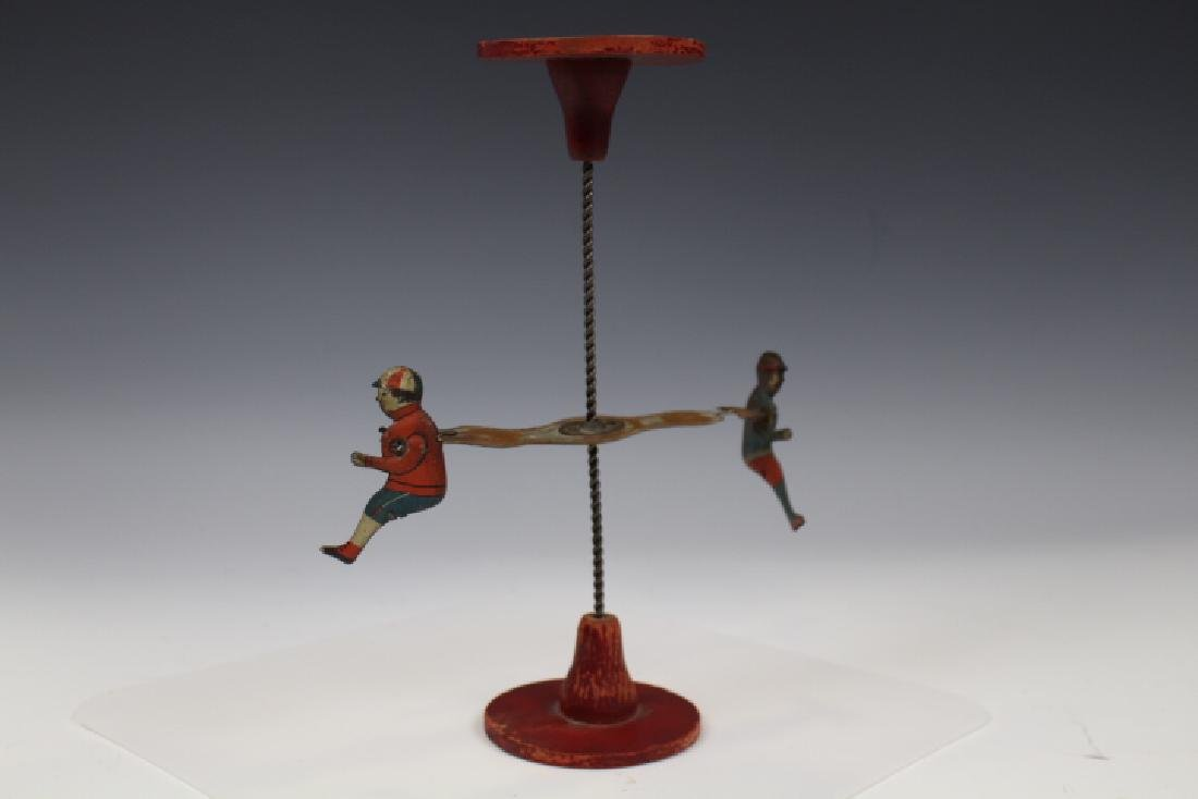Late 19th C Spiral Turning Toy w/ Boy & Girl