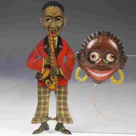 Lot of 2 Black Americana Spring Action Tin Toys