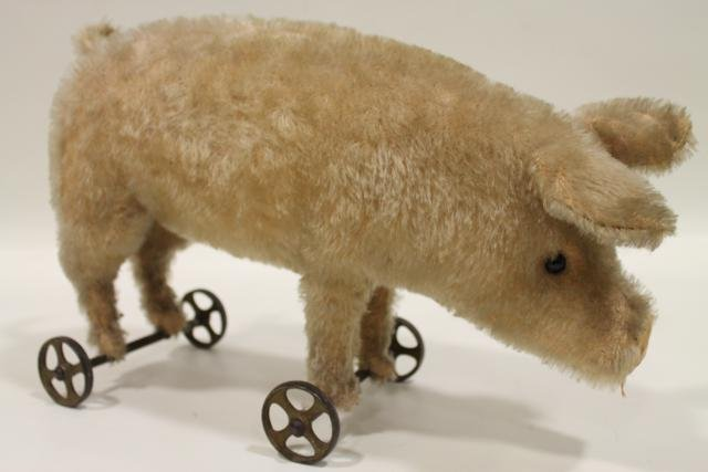21: Early Steiff Pig on Wheels