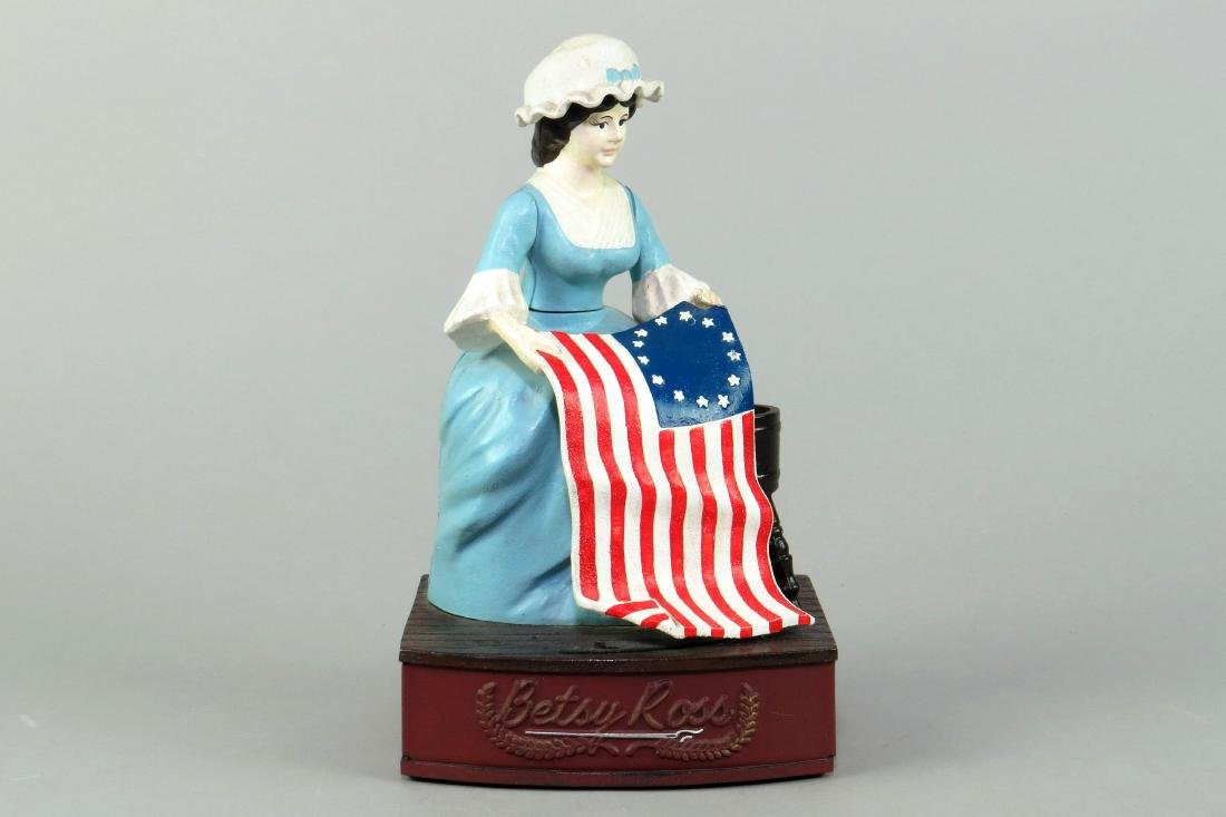 "Alum. ""Betsy Ross"" Mechanical Bank"
