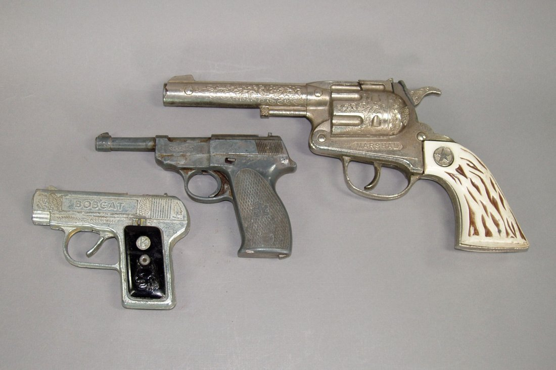 "2: Lot of 3 Toy Cap Guns:  ""Marshall""; ""Cap Gun""; ""Bobc"
