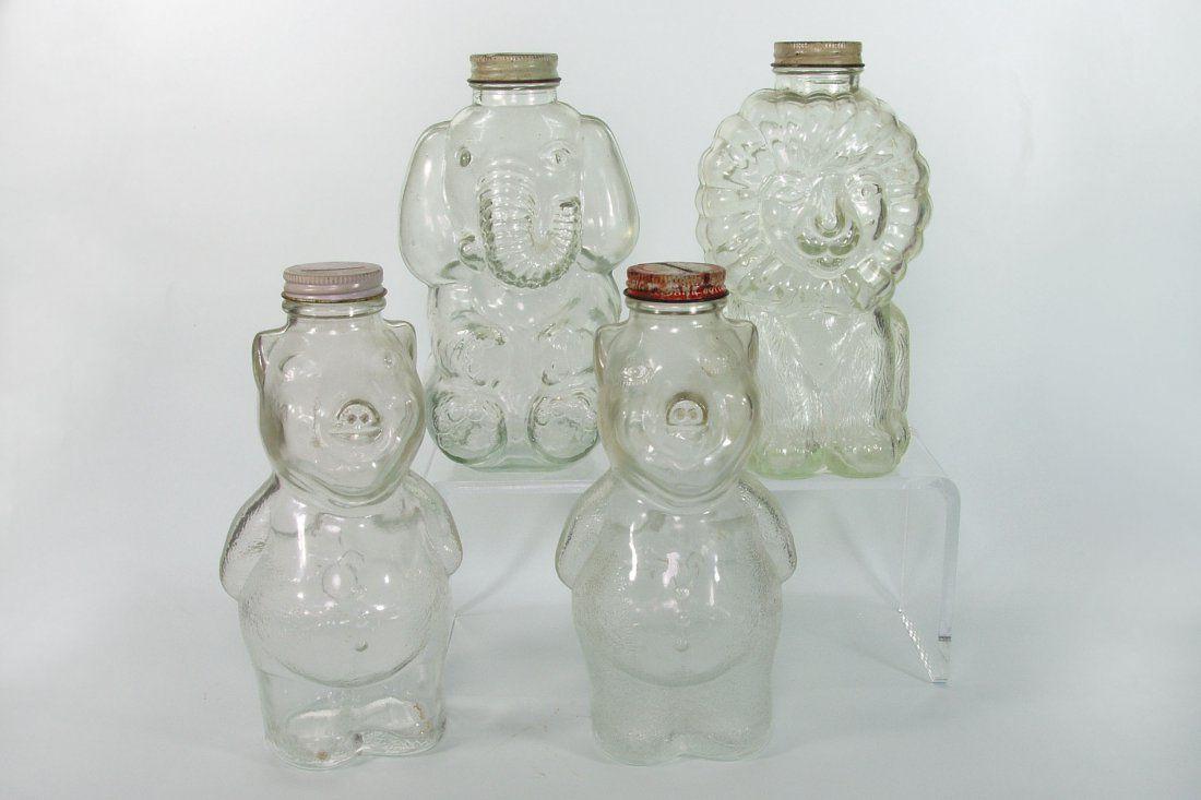 Lot of 4 Glass Bottle Still Banks