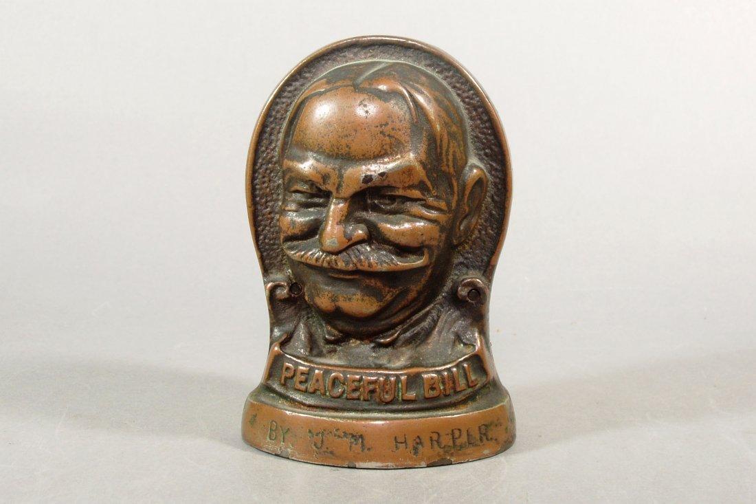 """Smiling Jim - Peaceful Bill"" Bank, cast iron"
