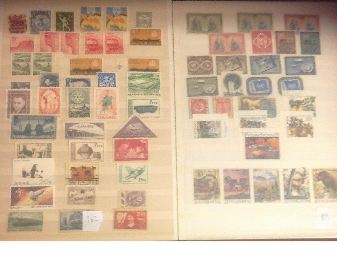 Worldwide stamp collection stored in red stockbook 22 - 6