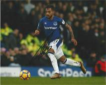 Theo Walcott Signed Everton 8x10 Photo. Good Condition.