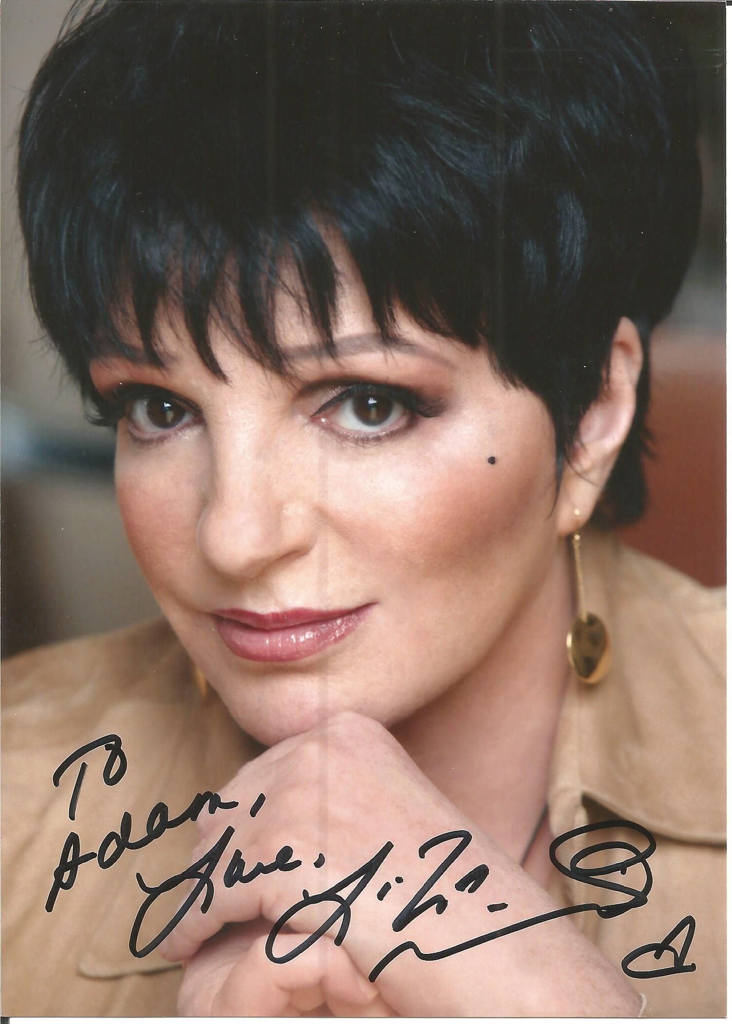 Liza Minnelli signed 7x5 colour photo. Dedicated. Good