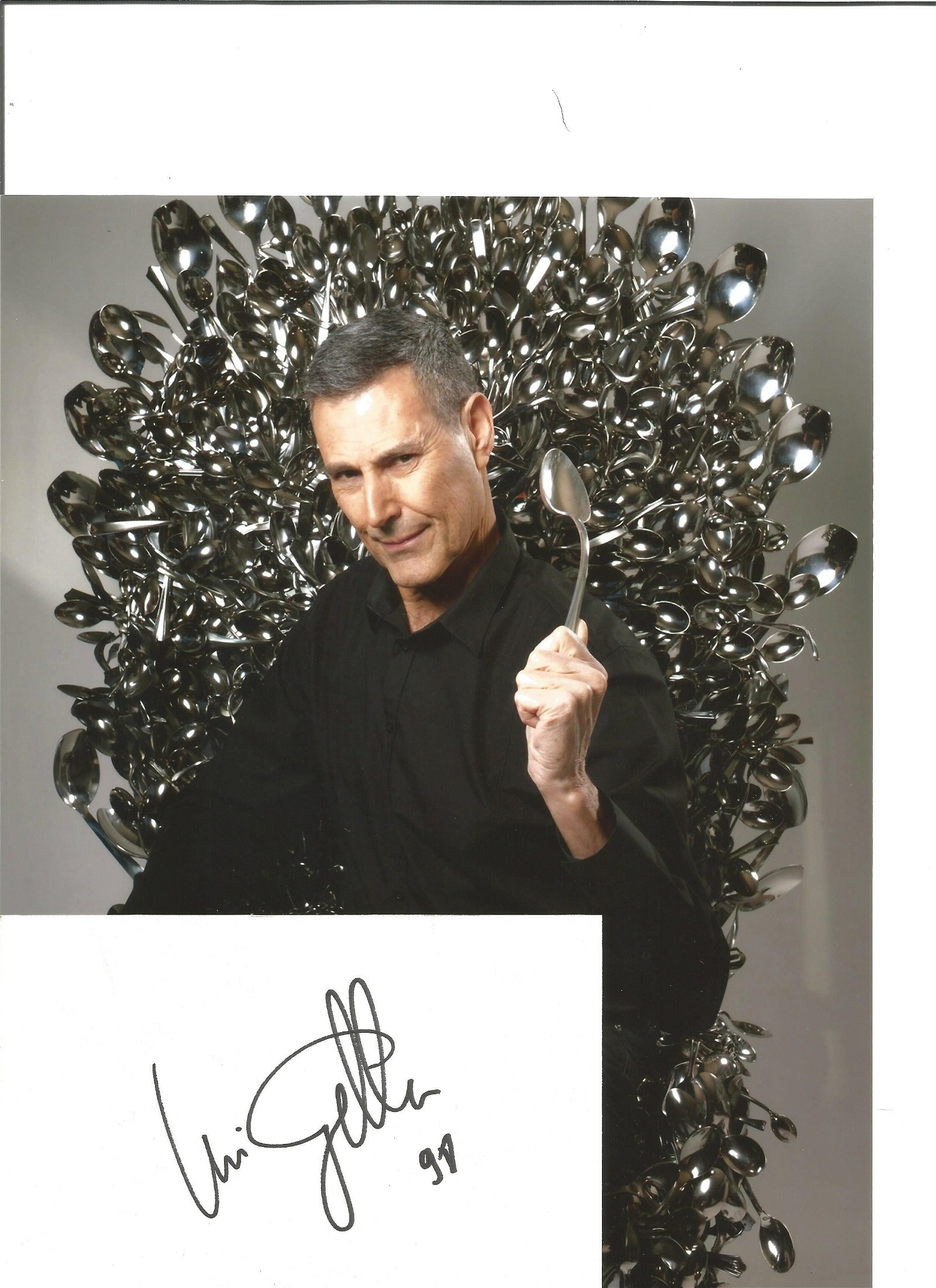 Uri Geller signed white card with 10x8 colour photo.