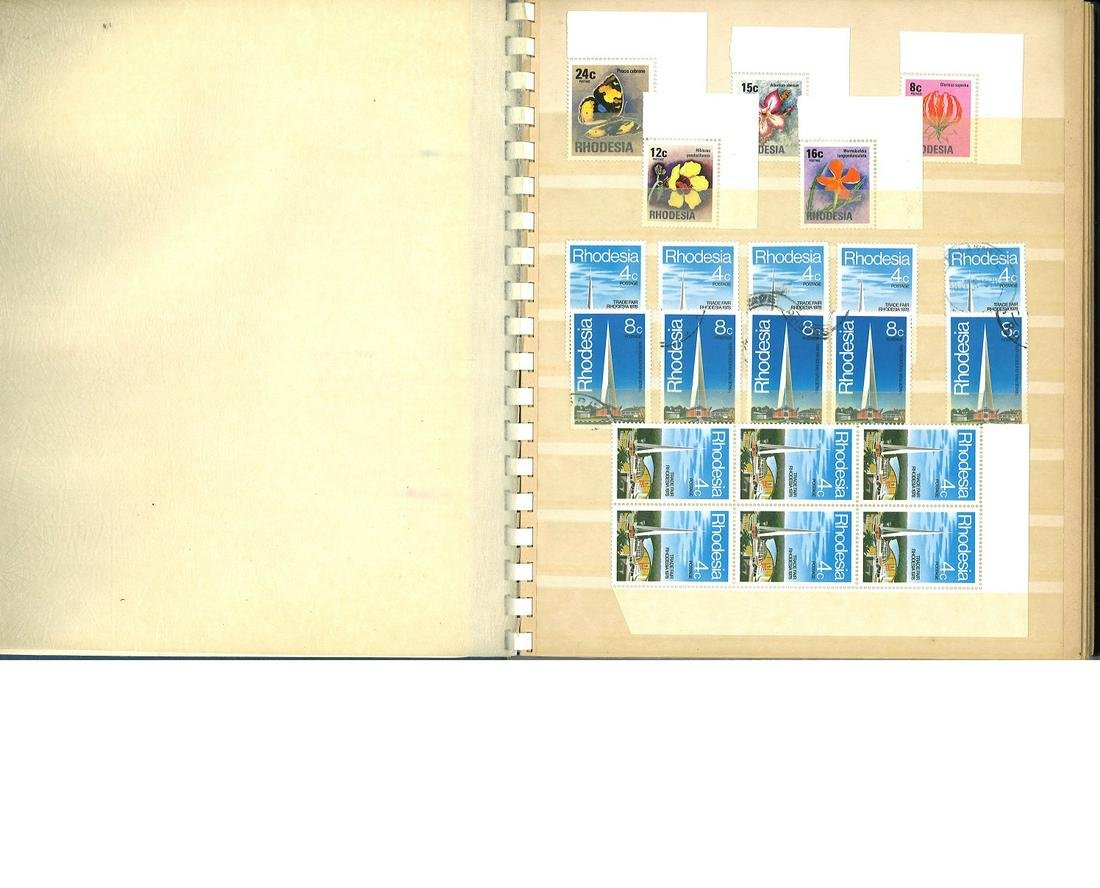 Worldwide stamp collection in blue stock book. Over 200