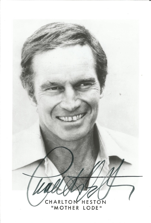 Charlton Heston signed 7x5 black and white photo. Good