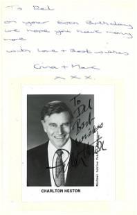 Charlton Heston signed photo fixed inside hardback book