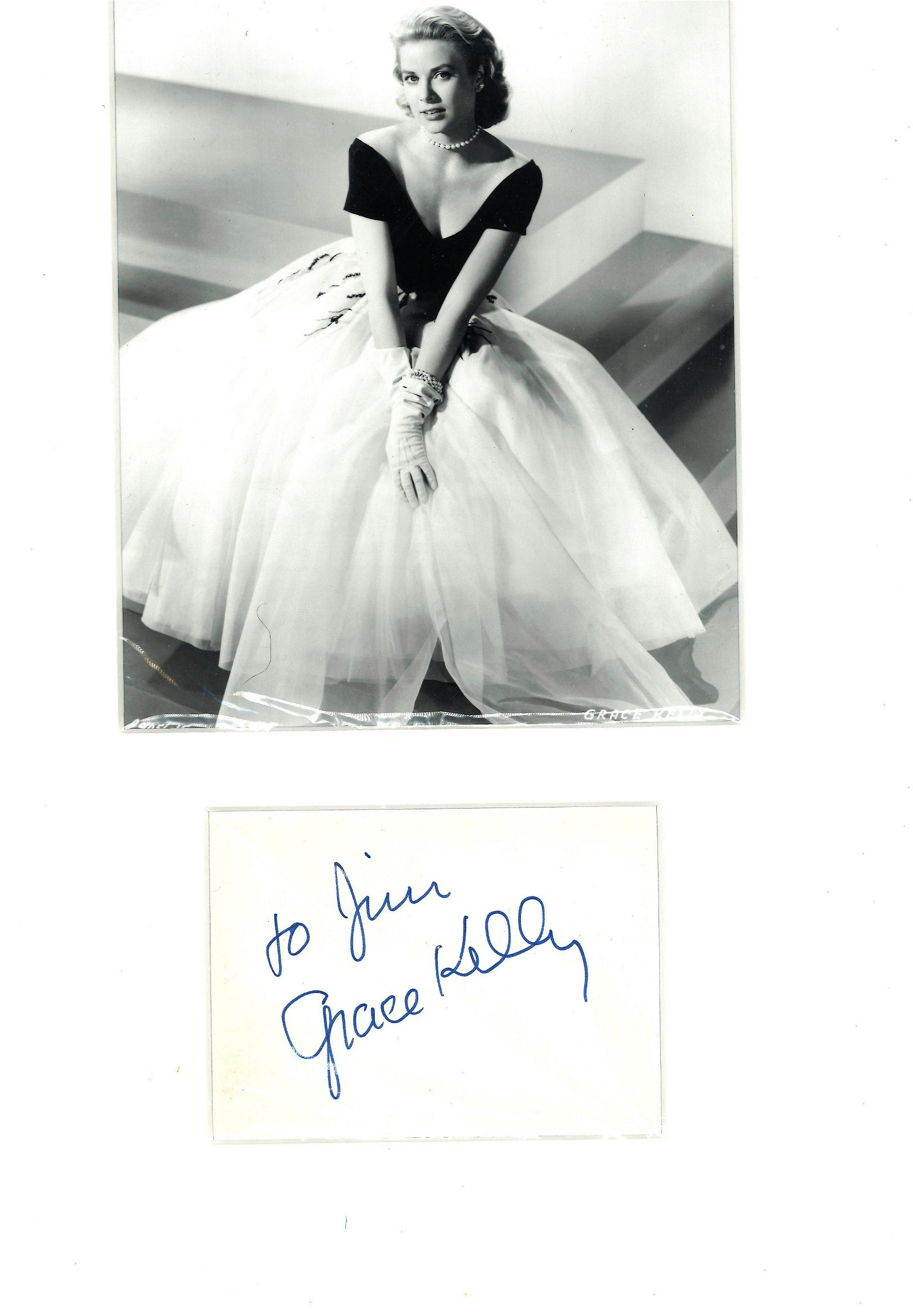 Grace Kelly signature piece mounted below black and