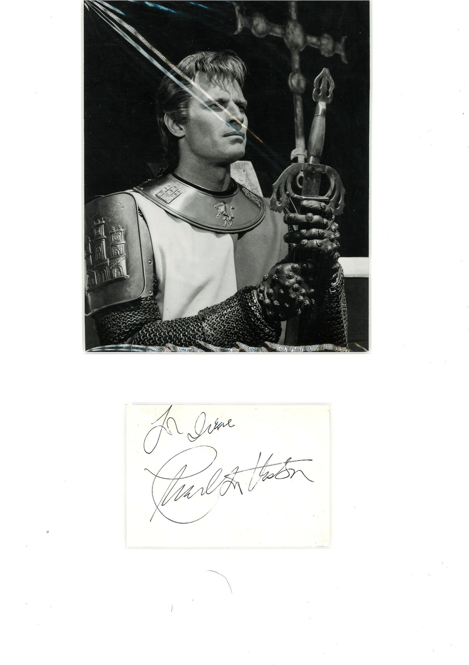 Charlton Heston signature piece mounted below black and
