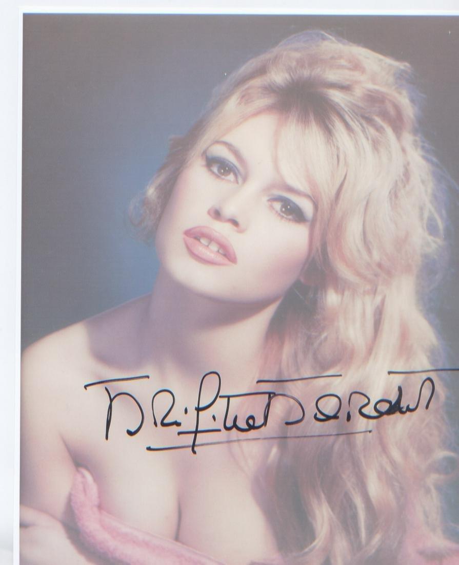 Brigitte Bardot signed 10 x 8 inch photo. Good