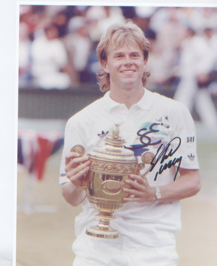 Stefan Edberg signed 10 x 8 inch photo holding the