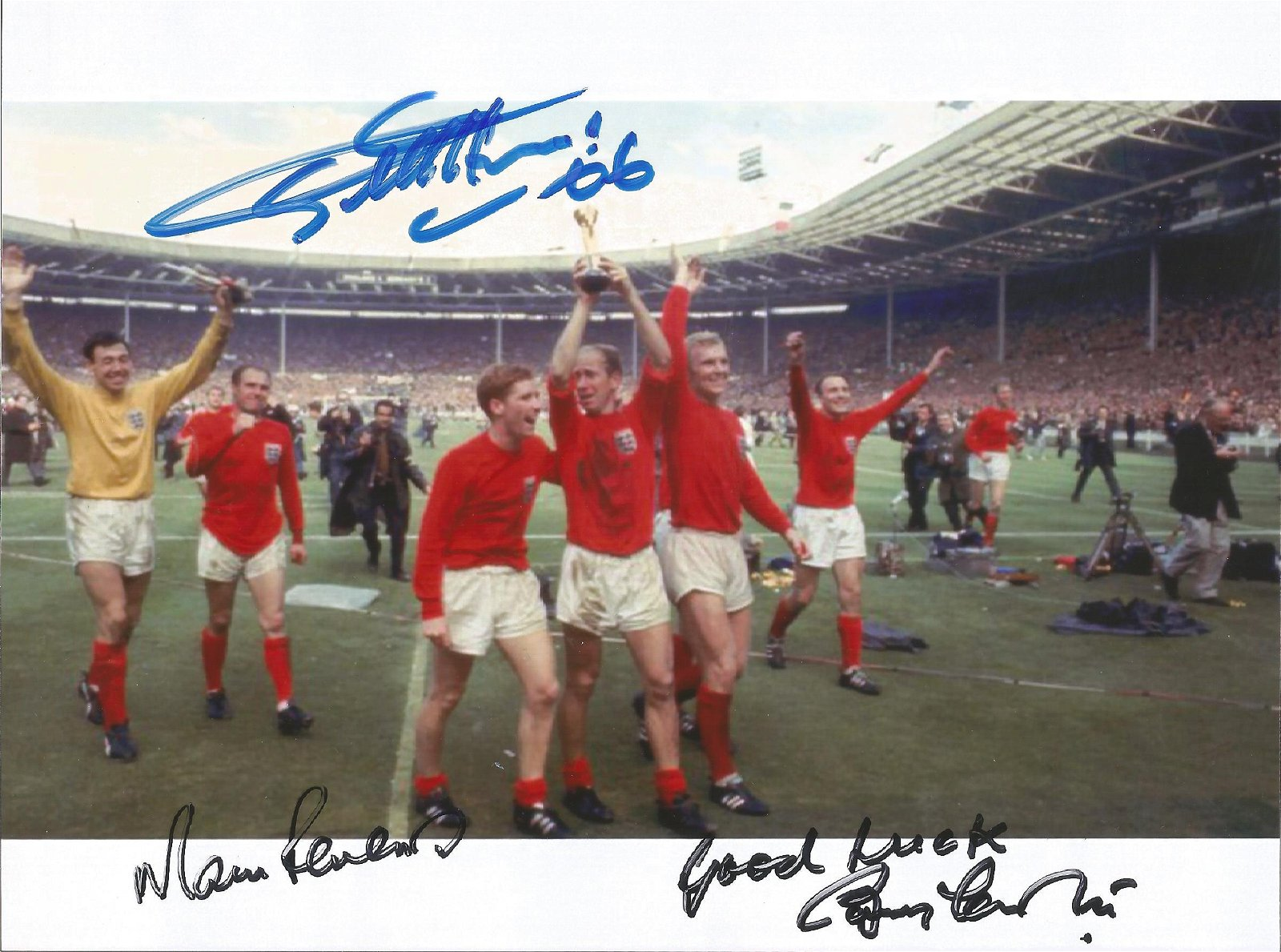 Geoff Hurst, Martin Peters and Bobby Charlton signed