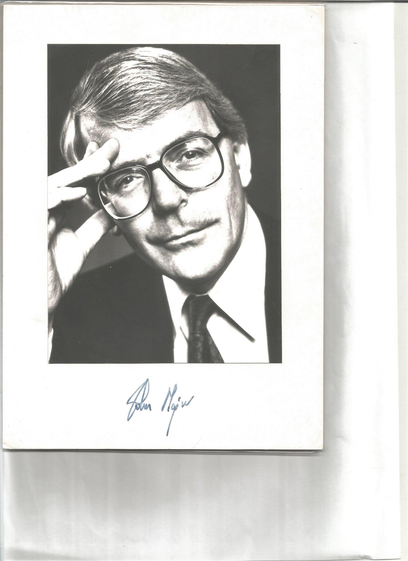 John Major signature piece below black and white photo.