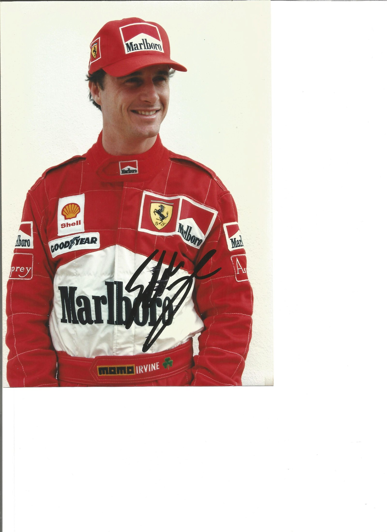 Eddie Irvine signed 8x6 colour photo. Slightly smudged.