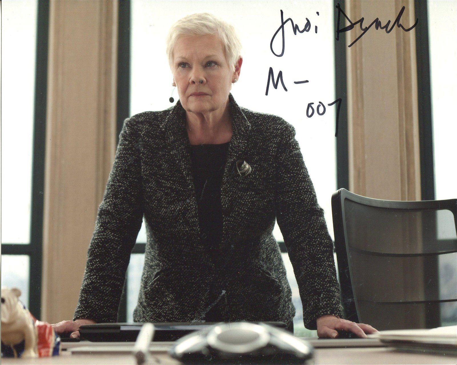 007 James Bond. 8x10 photo signed by Dame Judi Dench as