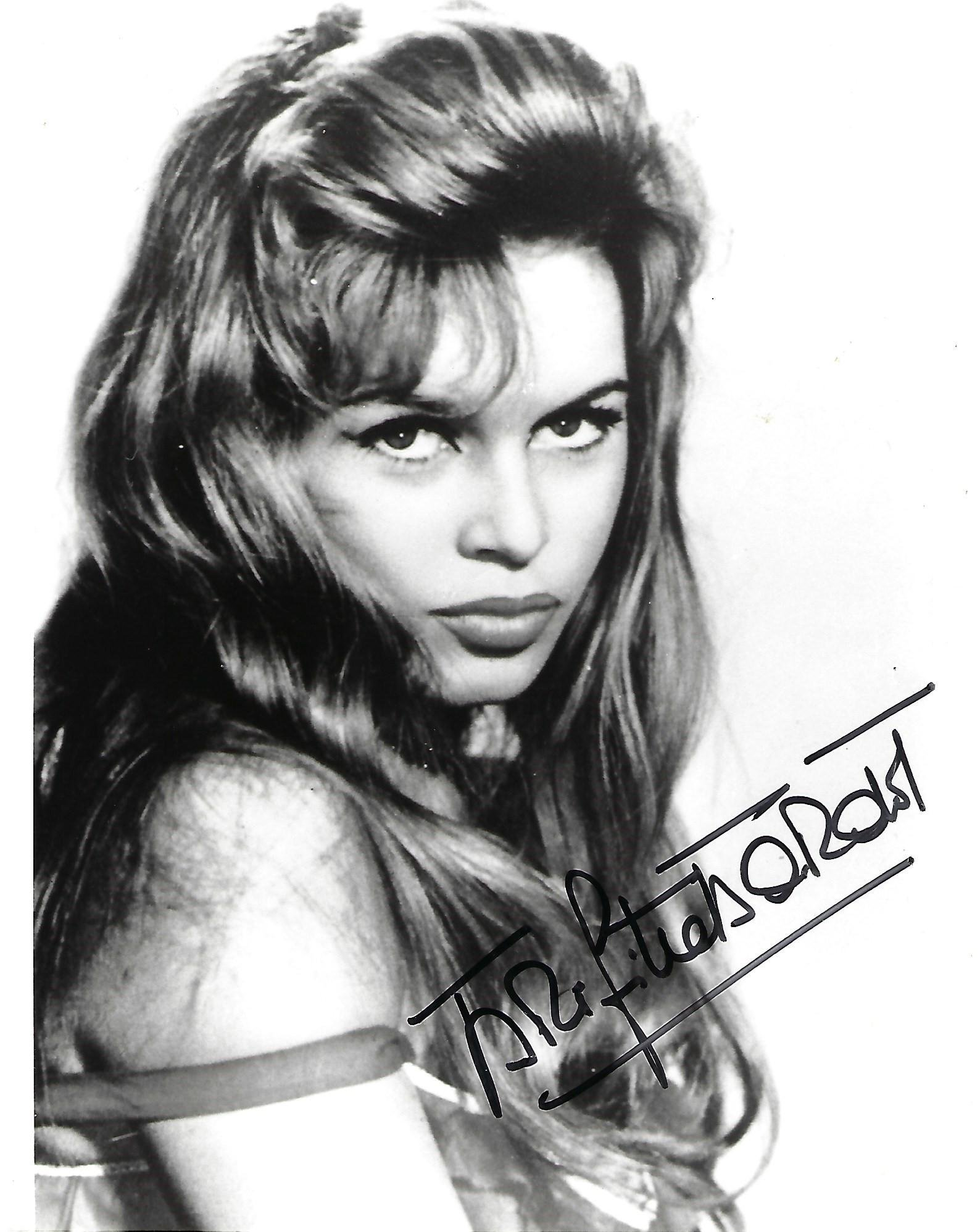 Brigitte Bardot signed sexy 10 x 8 inch b/w photo.