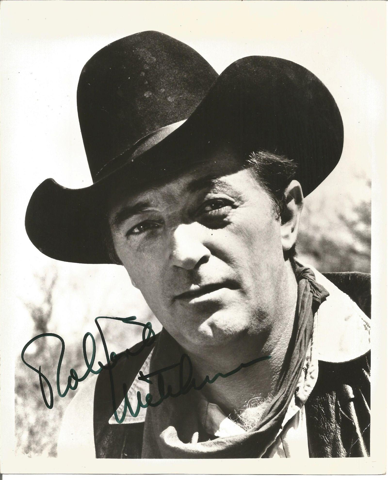 Robert Mitchum Signed 10 x 8 b/w photo. Condition 8/10.