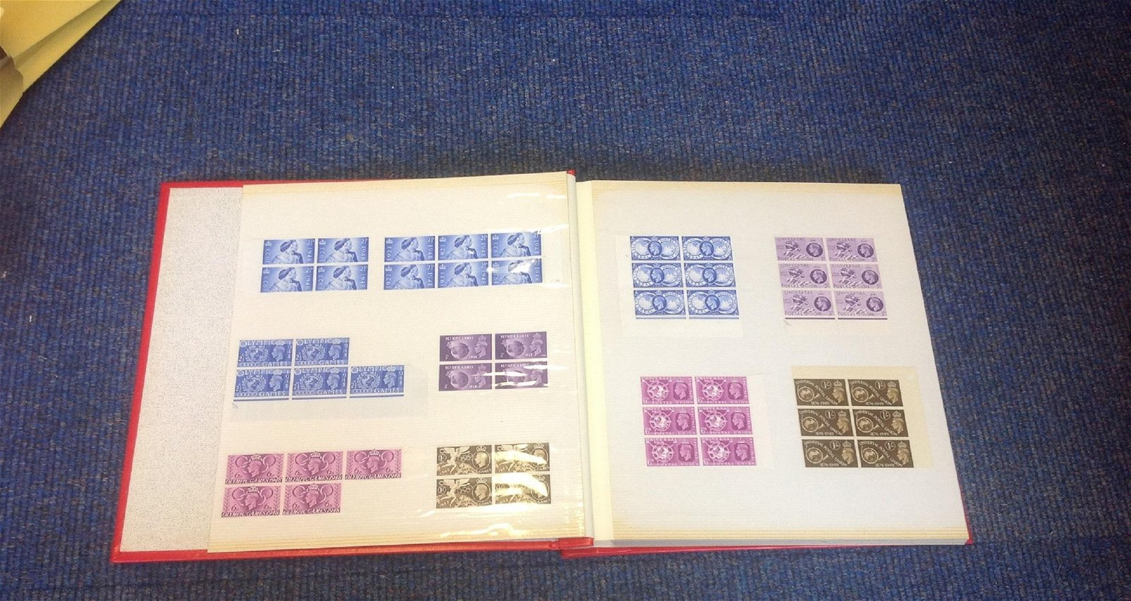 GB stamp collection in large red photo album, Mainly