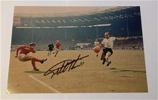 Geoff Hurst signed 12 x 8 inch colour photo scoring in
