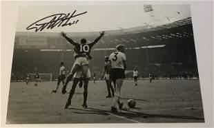 Geoff Hurst signed 12 x 8 inch b/w photo celebrating