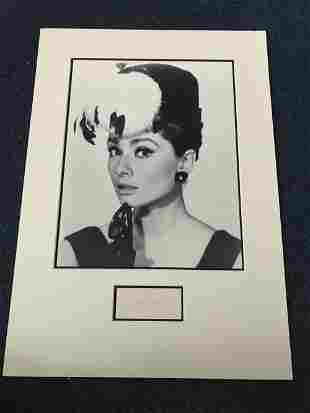 Audrey Hepburn signed piece mounted with b/w portrait
