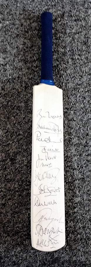Cricket multi signed miniature bat signed by 11 ex