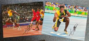 Usain Bolt collection 2 signed 16x12 colour photo.