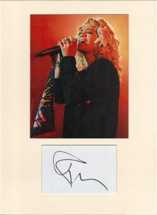Rita Ora signed card piece. Photo attached. 16 x 12.