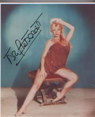 Brigitte Bardot signed 10 x 8 inch photo . Good