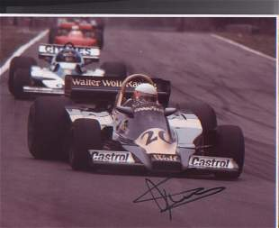Jody Scheckter signed 10 x 8 inch photo during F1 race.