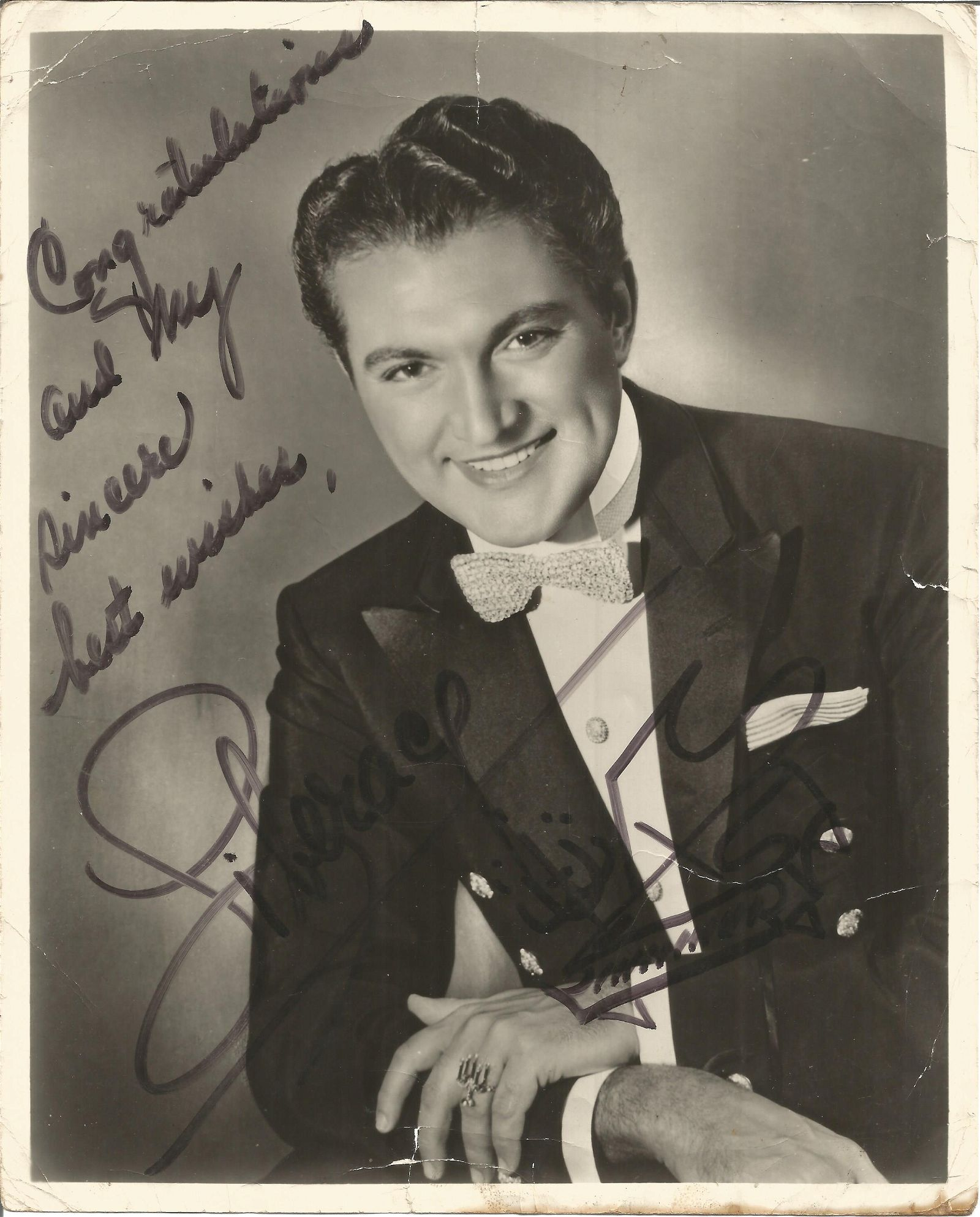 Liberace signed 10x8 black and white photo. Showing