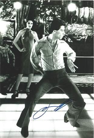John Travolta signed 12x8 black and white photo. Slight