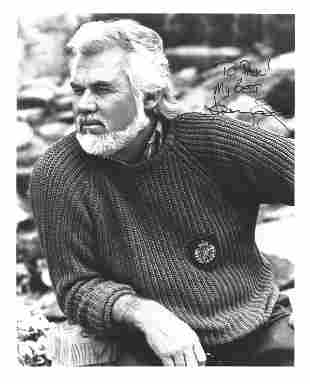 Kenny Rogers signed 10x8 black and white photo. Good
