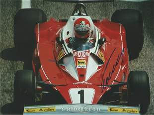 Niki Lauda signed 10x8 colour photo pictured driving