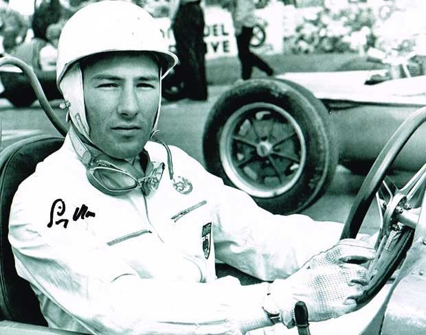 Stirling Moss Racing Driver 10 X 8 signed photo. Good