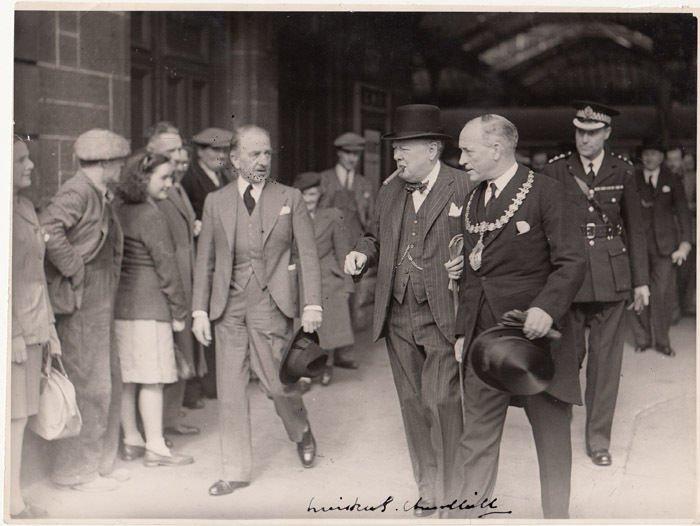 Winston Churchill signed photo. A 19cm x 25cm b/w press