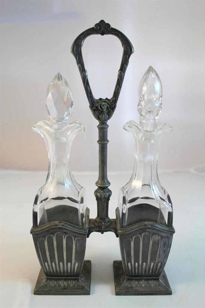 22: Antique Cruet Bottle Set in Silverplate Stand