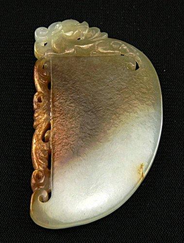 16: An Antique White Jade Pendant